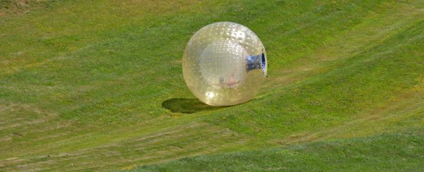 zorbing down a hill in New Zealand