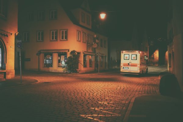 ambulance on cobblestone street at night