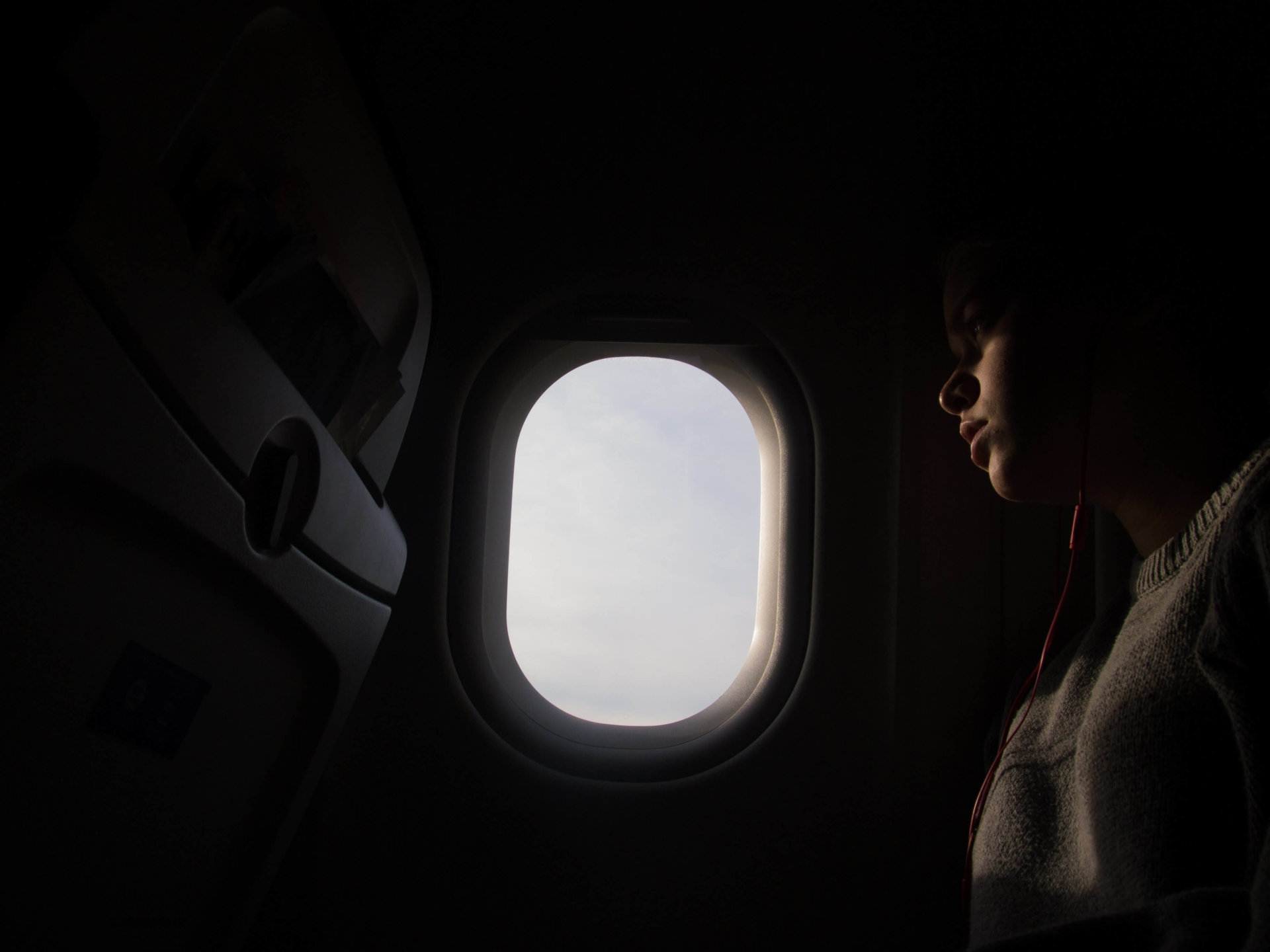 person looking out an airplane window