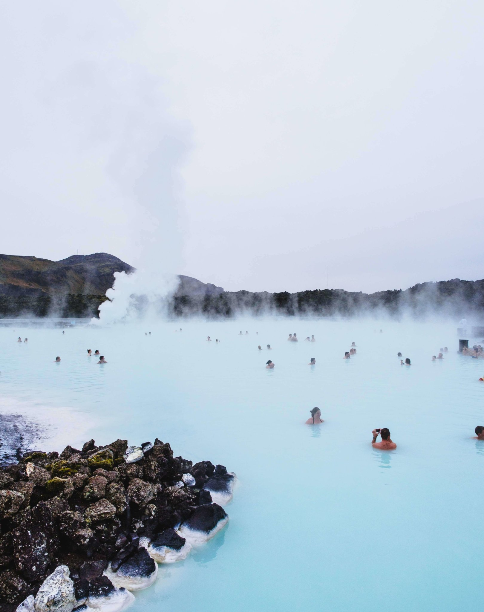 people swimming in hot pools in Iceland