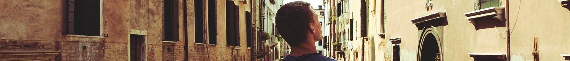 man in Italy looking at buildings