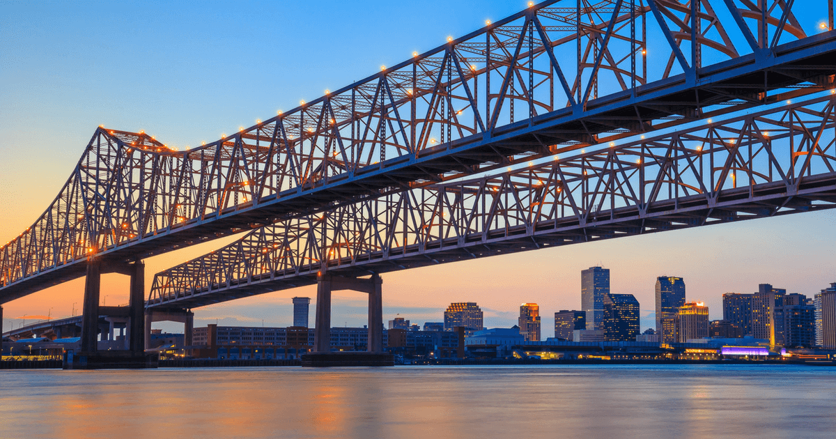 New Orleans bridge with skyline in background