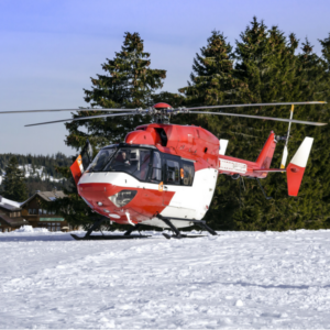 helicopter landing on snowy hill for a medical evacuation