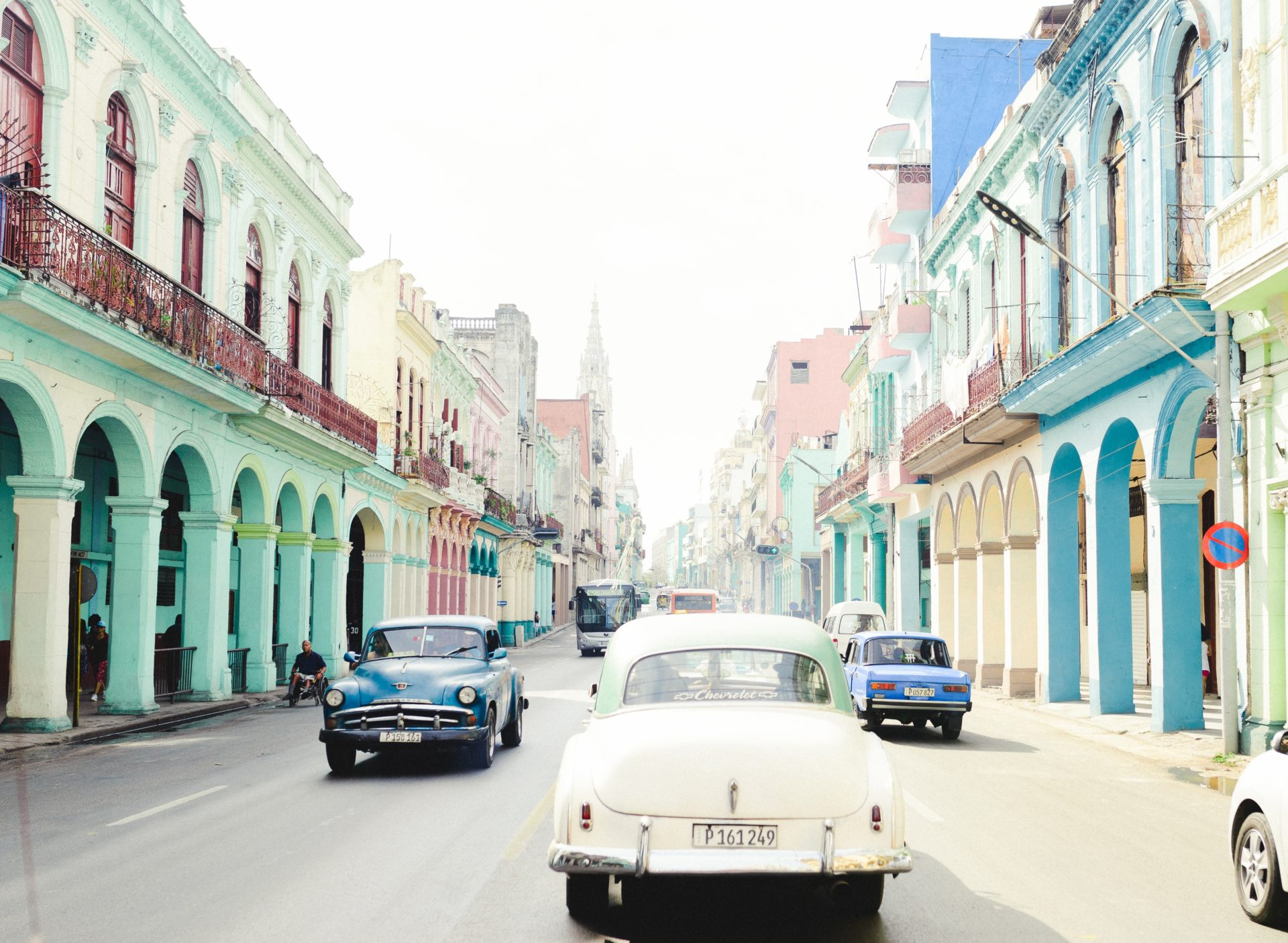 cuba street with classic cars and colorful buildings