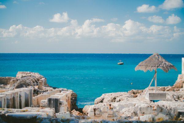 rocky shore by blue ocean