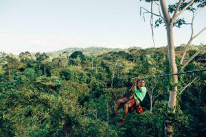 man on a zipline in Costa Rica