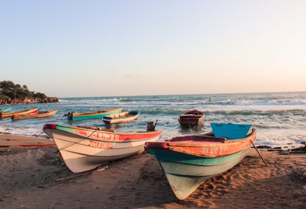 boats on beach in Jamaica